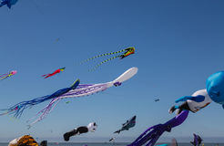 Flying kites. NORDEN-NORDDEICH, GERMANY - MAY 26, 2017: International Kite Festival with numerous flying kites at the beach on May 26, 2017 in Norden-Norddeich Royalty Free Stock Photos