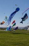 Flying kites. NORDEN-NORDDEICH, GERMANY - MAY 26, 2017: International Kite Festival with numerous flying kites at the beach on May 26, 2017 in Norden-Norddeich Stock Photography
