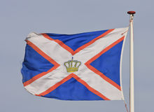 Flying KNRM flag, Ameland, Holland Stock Image