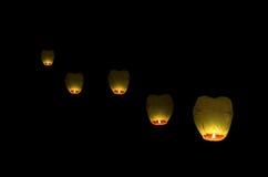 Flying lantern in the dark sky Stock Photography