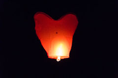 Flying lantern in the dark sky Royalty Free Stock Image