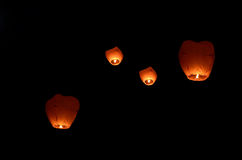 Flying lantern in the dark sky Royalty Free Stock Images