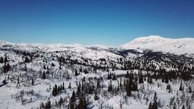 Flying in large mountain winter landscape stock footage