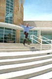 Flying Leap. Man takes a flying leap off some business building step Stock Photography