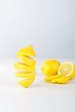 Flying lemon. Sliced lemon on white background. Levity fruit floating in the air. Stock Photo