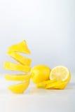Flying lemon. Sliced lemon on white background. Levity fruit floating in the air. Stock Image
