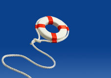 Flying life preserver for help Stock Photography
