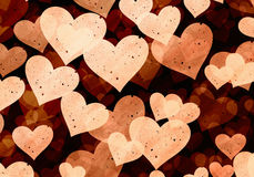 Flying light grainy hearts on brown backgrounds Stock Images