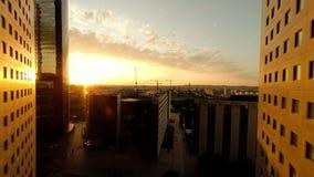 Flying into the light sunset city skyline real estate landmarks stock footage