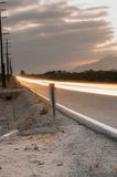 Flying lights over paved highway. Royalty Free Stock Photography