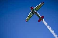Flying Lion - ZU-BET - Barrel Roll Maneuver. One of the Castrol Flying Lions Harvard aerobatic team, who treated spectators to a marvelous display of formation Royalty Free Stock Photos