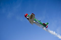 Flying Lion - ZU-BEU - Barrel Roll Maneuver. One of the Castrol Flying Lions Harvard aerobatic team, who treated spectators to a marvelous display of formation Stock Image