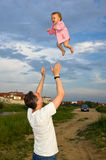 Flying little baby with father Royalty Free Stock Image