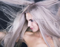 Flying long grey hair Royalty Free Stock Images