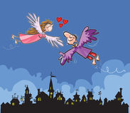 Flying lovers over the town. Stock Photo