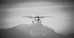 Flying low. Small plane flying over Carpathians Royalty Free Stock Photography