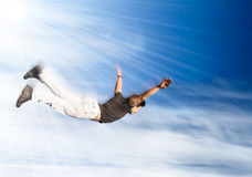 Flying man. Young man falling down on sky background royalty free stock photos