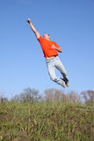 Flying man. In red t-shirt Stock Photos