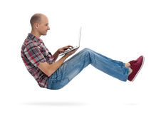 Flying man with laptop computer Royalty Free Stock Images