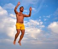 Flying man over beautiful sky Stock Photos
