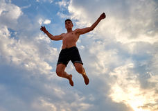 Flying man over beautiful sky Stock Image