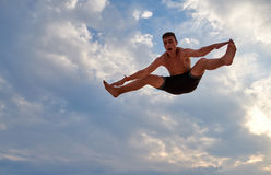 Flying man over beautiful sky Royalty Free Stock Photo