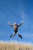 Flying man over the field Royalty Free Stock Photos