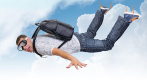 Flying man with satchel (parachute) in clouds. Background Royalty Free Stock Images