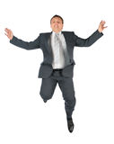 Flying man in suit Stock Images
