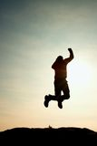 Flying man. Young man falling down on sky background. Stock Images