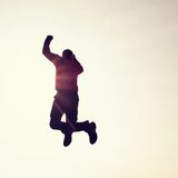Flying man. Young man falling down on sky background. Super man fly. Young man falling down on colorful sky background Royalty Free Stock Image