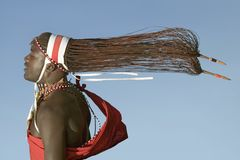 Flying Masai appears to float in air with his hair hanging behind him, Lewa Wildlife Conservancy, North Kenya, Africa Stock Photos