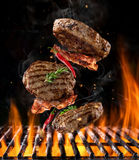 Flying meat above grill Stock Images