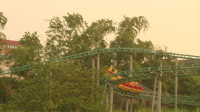 Flying with Merry-go-round over the trees. stock video footage