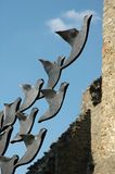 Flying metal doves. Metal squares turn into doves and fly up Stock Image