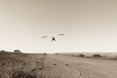 Flying Microlight Aircraft Sepia Royalty Free Stock Photos