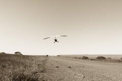 Flying Microlight Aircraft Sepia Royalty Free Stock Photos