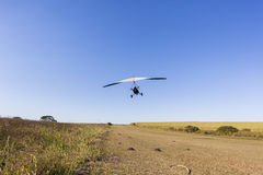 Flying Microlight Aircraft Take-Off Stock Image