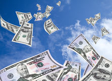 Flying Money. Money flying with sky background Stock Image
