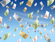 Flying money. Flying euros on sky background Stock Images