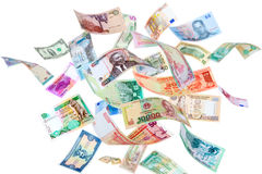 Flying money from around the world Stock Image