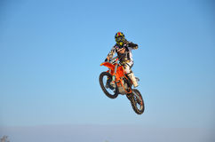 Flying on a motorcycle with one hand Stock Photo