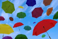 Flying of multicoloured umbrellas Royalty Free Stock Photos