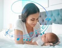 Free Flying Music Notes And Woman With Her Newborn Baby On Bed. Lullaby Songs Stock Photos - 186363403
