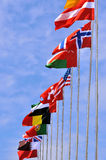 Flying national flags of different country. Different countries national flags on pole as line, shown as world, country, and international communication or Stock Photography