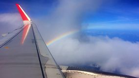 Flying next to rainbow. Airplaine passing next to the rainbow peak stock video footage