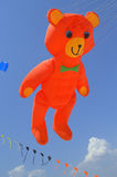Flying orange bear kite Royalty Free Stock Photo