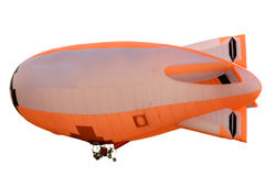 Flying orange blimp. Isolated on white background stock photo