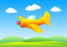 Flying orange plane Stock Photo