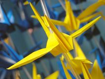 Flying origami Stock Image